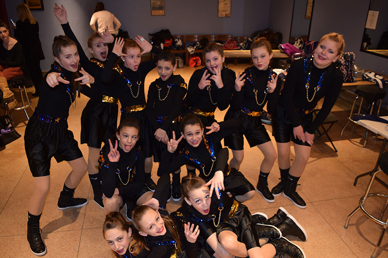 girls dance team posing together
