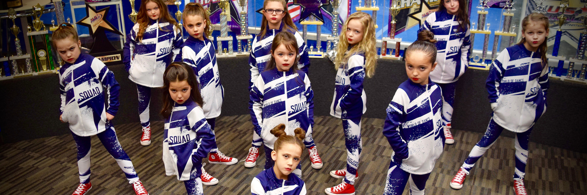 girls in matching dance uniforms posing