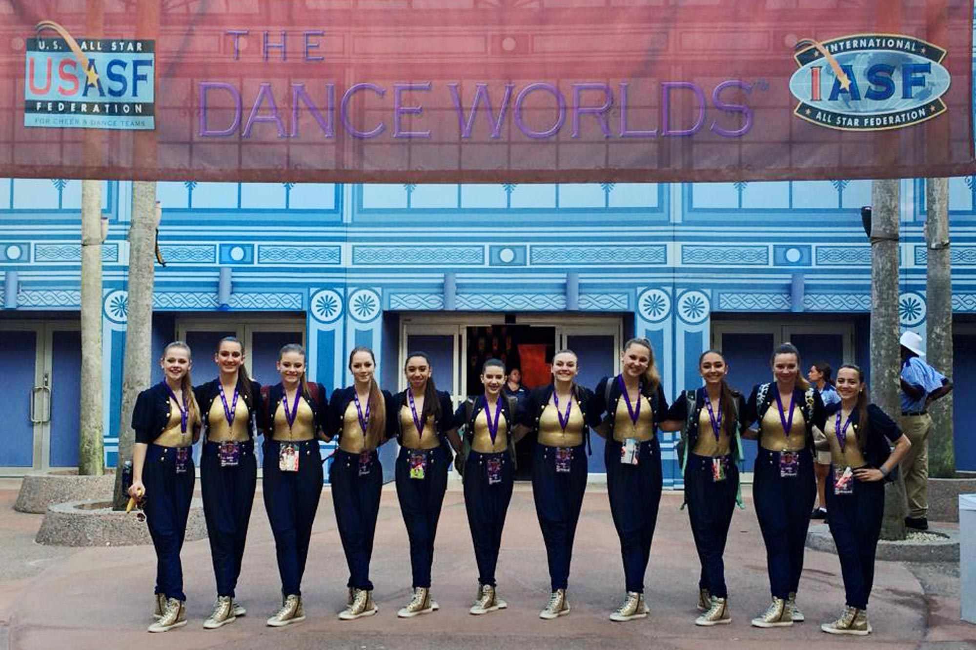 girl dance team in matching uniforms posing together
